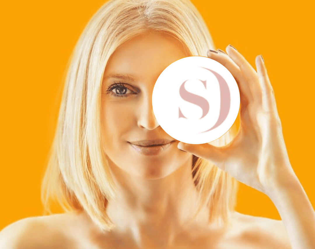London Clinic- Pretty girl holding Dermasurge Logo on a yellow background